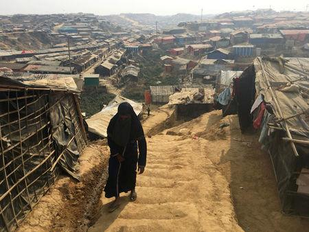 A woman walks up a hill in the Kutupalong camp for Rohingya refugees in southern Bangladesh