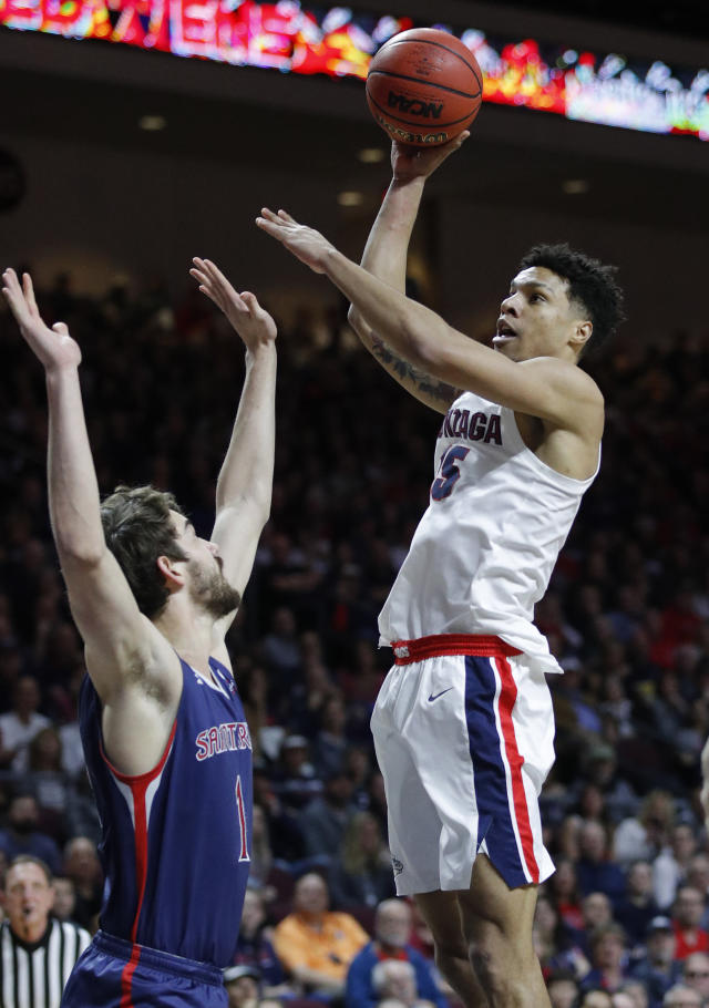 Gonzaga's Brandon Clarke shoots over St. Mary's Jordan Hunter during the first half of an NCAA college basketball game for the West Coast Conference men's tournament title, Tuesday, March 12, 2019, in Las Vegas. (AP Photo/John Locher)