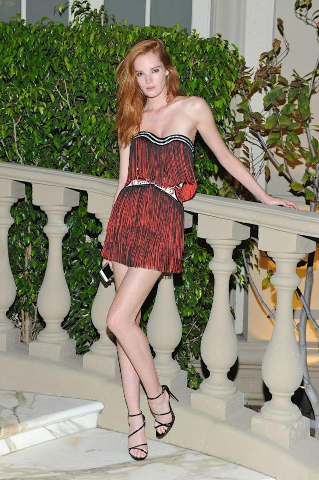 <p>The model rocked a red hot fringe number. (Photo by Donato Sardella/Getty Images for BALMAIN) </p>