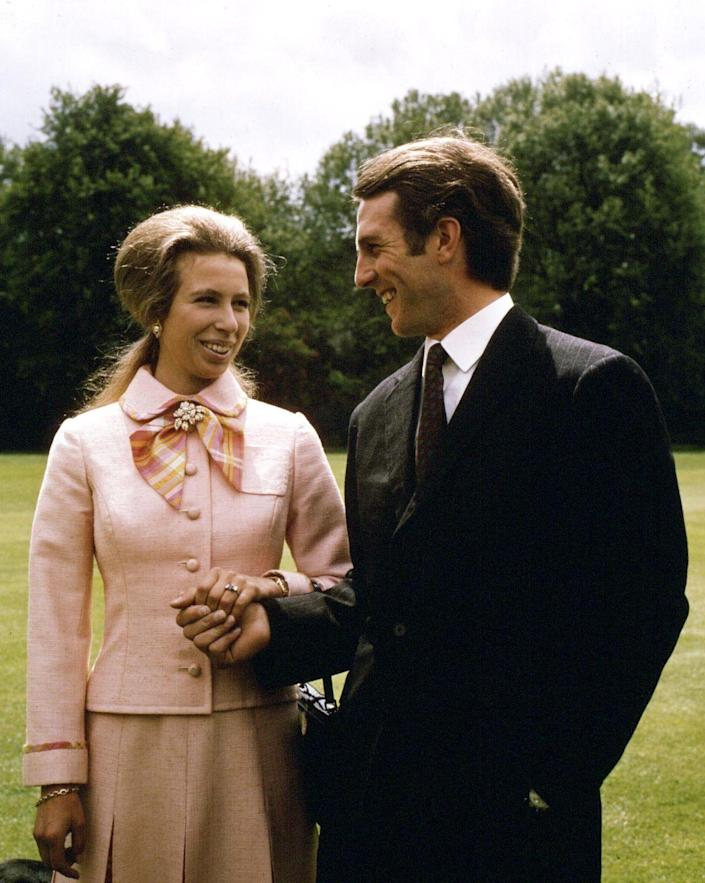 """<p>The Princess Royal and Captain Mark Phillips announced their engagement on the lawn of Buckingham Palace in 1973. Princess Anne, a keen equestrian, met the Olympic medal rider <a href=""""https://www.harpersbazaar.com/celebrity/latest/a30065406/princess-anne-husband-relationships-true-story/"""" rel=""""nofollow noopener"""" target=""""_blank"""" data-ylk=""""slk:at a party in 1968"""" class=""""link rapid-noclick-resp"""">at a party in 1968</a>, and the two bonded over their love of horses. </p>"""