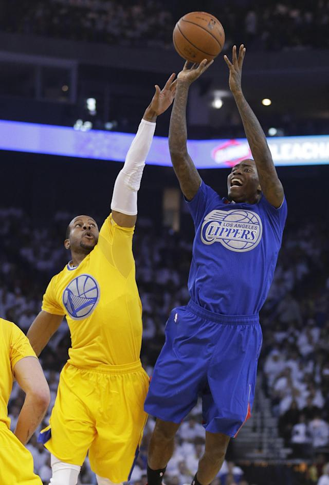 Los Angeles Clippers guard Jamal Crawford (11) takes a shot over Golden State Warriors forward Andre Iguodala (9) during the first half of an NBA basketball game, Wednesday, Dec. 25, 2013, in Oakland, Calif. (AP Photo/Tony Avelar)