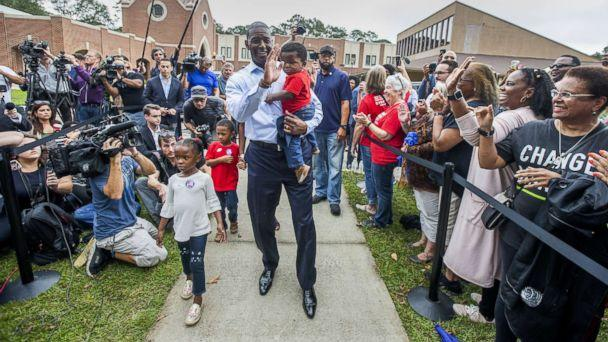 PHOTO: Tallahassee mayor and Florida Democratic gubernatorial candidate Andrew Gillum waves at supporters after casting his ballot with his children on Nov. 6, 2018 in Tallahassee, Fla. (Mark Wallheiser/Getty Images)