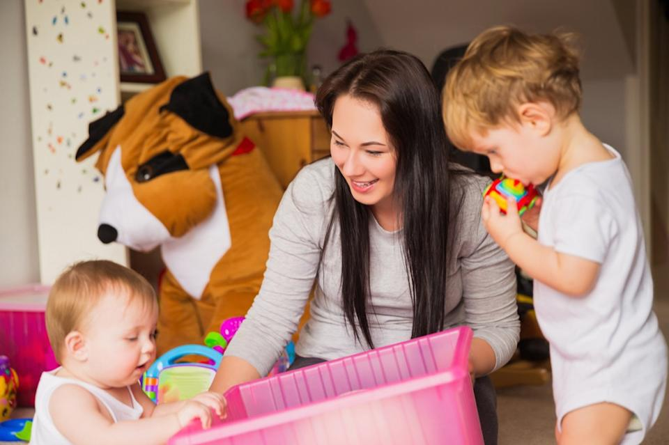 babysitter playing with kids, working mom