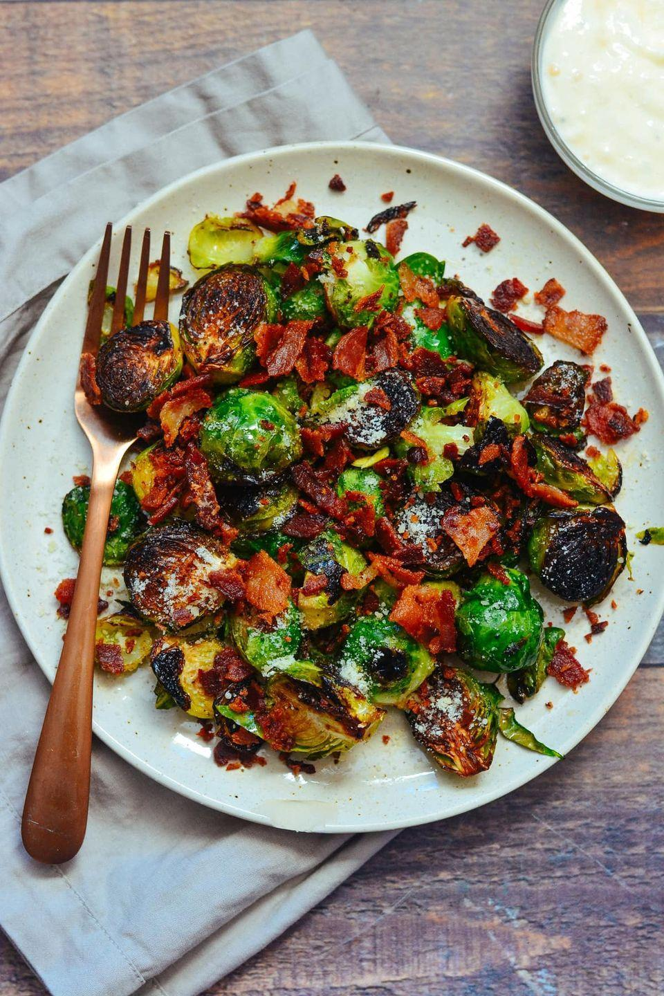 """<p>This is one of <em>two</em> different Brussels sprouts recipes we're recommending, because they're both so different, and both so good! Here, generously crisped sprouts are paired with bacon and cheese, then dressed in a delicious aioli sauce.</p><p><strong>Get the recipe at <a href=""""https://cookswithsoul.com/pan-fried-brussels-sprouts-bacon-parmesan-garlic-aioli-sauce/"""" rel=""""nofollow noopener"""" target=""""_blank"""" data-ylk=""""slk:Cooks with Soul"""" class=""""link rapid-noclick-resp"""">Cooks with Soul</a>.</strong></p><p><strong><a class=""""link rapid-noclick-resp"""" href=""""https://www.amazon.com/dp/B07T3Q1DGQ/?tag=syn-yahoo-20&ascsubtag=%5Bartid%7C10050.g.33501494%5Bsrc%7Cyahoo-us"""" rel=""""nofollow noopener"""" target=""""_blank"""" data-ylk=""""slk:SHOP MIXING BOWLS"""">SHOP MIXING BOWLS</a><br></strong></p>"""