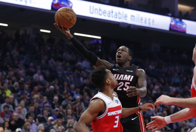 Miami Heat guard Kendrick Nunn goes to the basket against Sacramento Kings guard Yogi Ferrell during the first quarter of an NBA basketball game in Sacramento, Calif., Friday, Feb. 7, 2020. (AP Photo/Rich Pedroncelli)