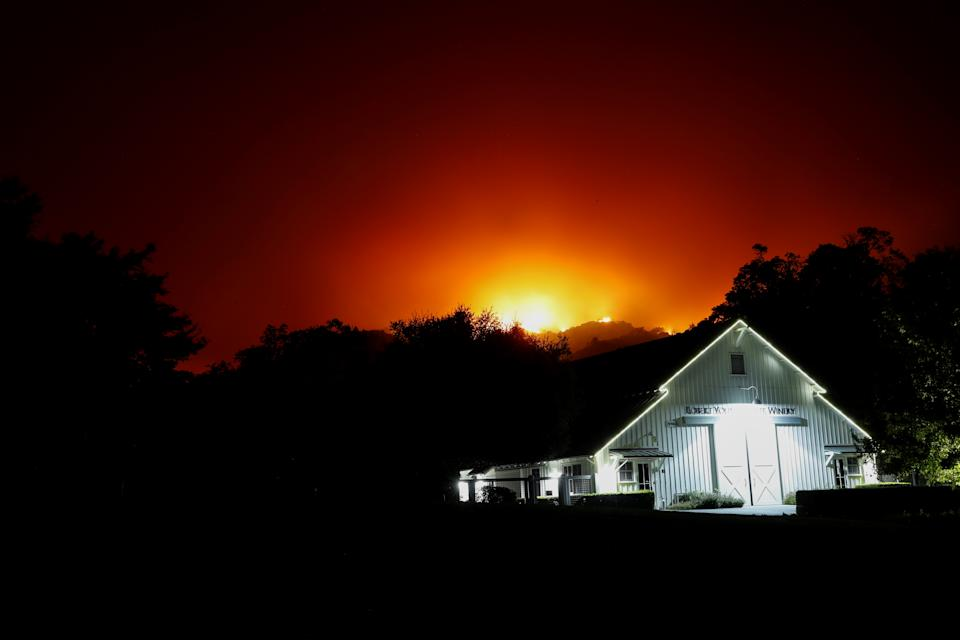The Robert Young Estate Winery is seen as the Kincade fire burns in the distance, in Geyserville, California, U.S. October 24, 2019. (Photo: Stephen Lam/Reuters)