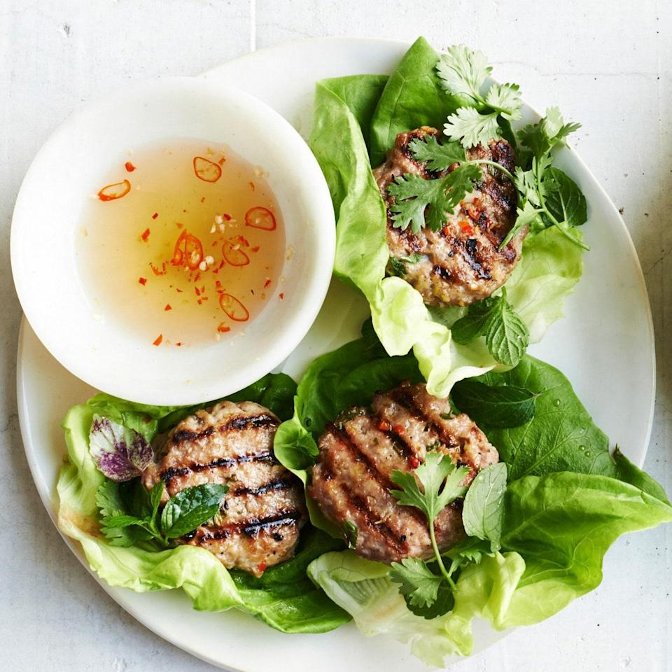 """In Vietnam, little pork patties like this are often grilled over charcoal right on the street and diners sit and eat on (<a href=""""http://www.ricepaperscissors.com/"""" rel=""""nofollow noopener"""" target=""""_blank"""" data-ylk=""""slk:now iconic"""" class=""""link rapid-noclick-resp"""">now iconic</a>) little plastic stools. You can serve these patties simply wrapped in the lettuce leaves here, as a snack, or over vermicelli noodles, as a larger meal. What's non-negotiable? Serve with plenty of herbs and the funky, salty, sour, sweet dipping sauce. <a href=""""https://www.epicurious.com/recipes/food/views/lemongrass-pork-patties-with-vietnamese-dipping-sauce-51237010?mbid=synd_yahoo_rss"""" rel=""""nofollow noopener"""" target=""""_blank"""" data-ylk=""""slk:See recipe."""" class=""""link rapid-noclick-resp"""">See recipe.</a>"""