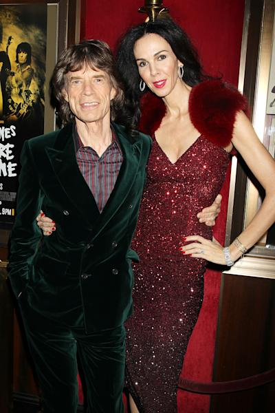 """FILE - This Nov. 13, 2012 file photo released by Starpix shows Mick Jagger of The Rolling Stones, left, and fashion designer L'Wren Scott at the HBO premiere of his film, """"Crossfire Hurricane,"""" in New York. Scott is to be remembered on Friday, May 2, 2014, at a Manhattan memorial service, expected to be attended by her longtime companion, Mick Jagger, and others close to her. The service for Scott, a noted fashion designer and stylist who committed suicide March 17, will be held at St. Bartholomew's Church. (AP Photo/Starpix, Dave Allocca)"""