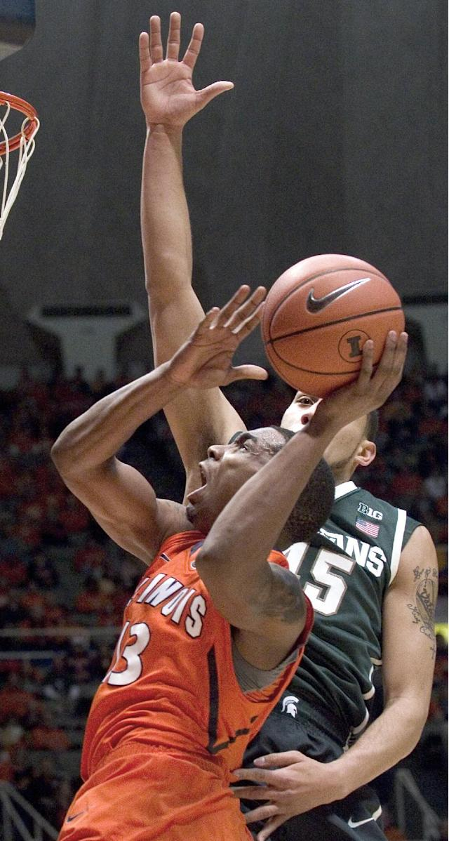 Illinois' Tracy Abrams (13) looks for a shot against Michigan State's Denzel Valentine (45) during an NCAA college basketball game in Champaign, Ill., on Saturday, Jan. 18, 2014. (AP Photo/Robin Scholz)