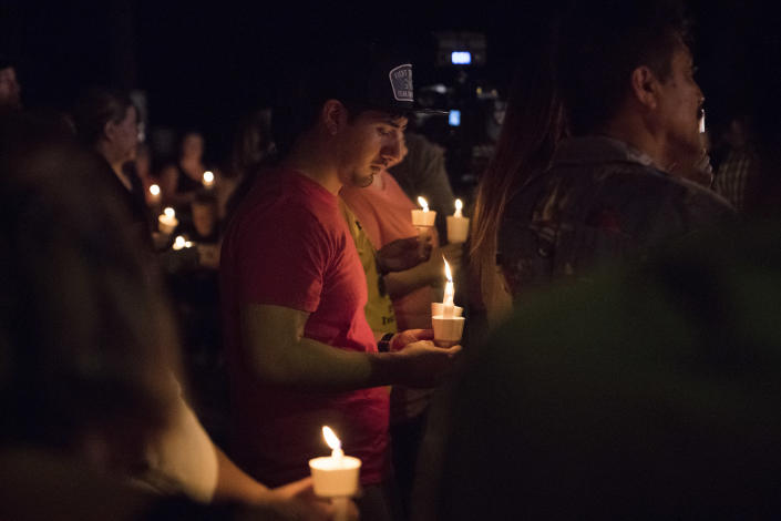 <p>Mourners participate in a candlelight vigil held for the victims of a fatal shooting at the First Baptist Church of Sutherland Springs, Nov. 5, 2017, in Sutherland Springs, Texas. (Darren Abate/AP) </p>