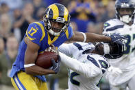 Los Angeles Rams wide receiver Robert Woods, left, pushes away Seattle Seahawks defensive back Delano Hill during the second half in an NFL football game Sunday, Nov. 11, 2018, in Los Angeles. (AP Photo/Alex Gallardo)