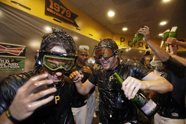 Pittsburgh Pirates' Jason Grilli, center, celebrates with Jeff Locke, left, after the Pirates defeated the Cincinnati Reds 6-2 in the NL wild-card playoff baseball game in Pittsburgh on Tuesday, Oct. 1, 2013. The Pirates advanced to the NL division series against the St. Louis Cardinals. (AP Photo/Gene J. Puskar)