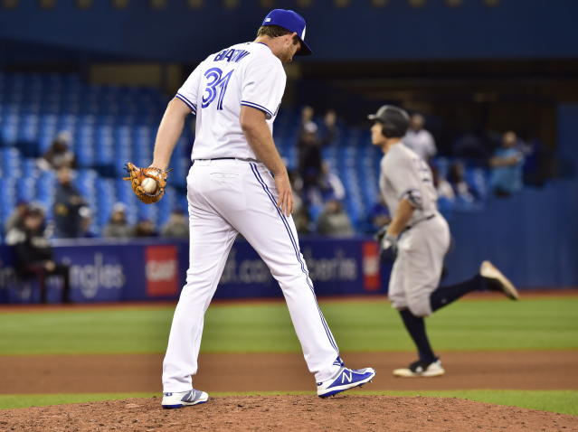Toronto Blue Jays relief pitcher Joe Biagini (31) looks down as New York Yankees' Aaron Judge (99) rounds the bases after hitting a home run during the 13th inning of a baseball game Wednesday, June 6, 2018, in Toronto. (Frank Gunn/The Canadian Press via AP)