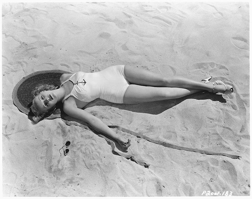 <p>Betty Grable takes a nap as she catches some rays in 1937.</p>