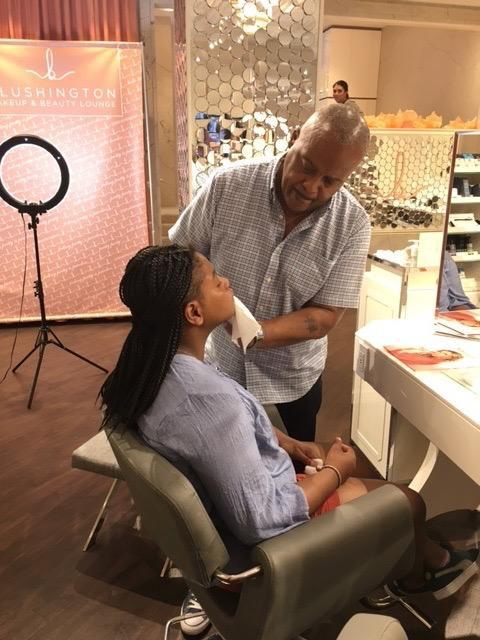 A dad cleansing his daughter's face. (Photo courtesy of Natasha Cornstein, CEO of Blushington)