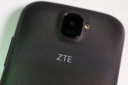 A ZTE smart phone is pictured in this illustration taken April 17, 2018.   REUTERS/Carlo Allegri/Illustration