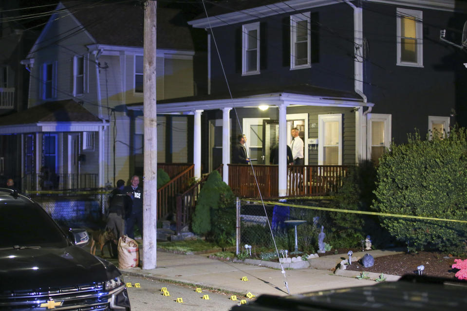Providence Police investigate a shooting on Carolina Avenue, late Thursday, May 13, 2021, in Providence, R.I. (AP Photo/Stew Milne)