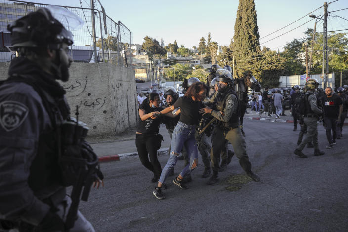 Israeli border police scuffle with protesters in the Sheikh Jarrah neighborhood of east Jerusalem, where several Palestinian families are under imminent threat of forcible eviction from their homes, May 15, 2021. / Credit: Mahmoud Illean/AP