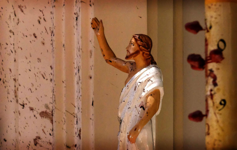 FILE - In this April 21, 2019, file photo, bloodstains a Jesus Christ statue at the St. Sebastian's Church after a blast in Negombo, north of Colombo, Sri Lanka. On Easter Sunday, April 21, bombs shattered the celebratory services at two Catholic churches and a Protestant church in Sri Lanka.  (AP Photo/File)