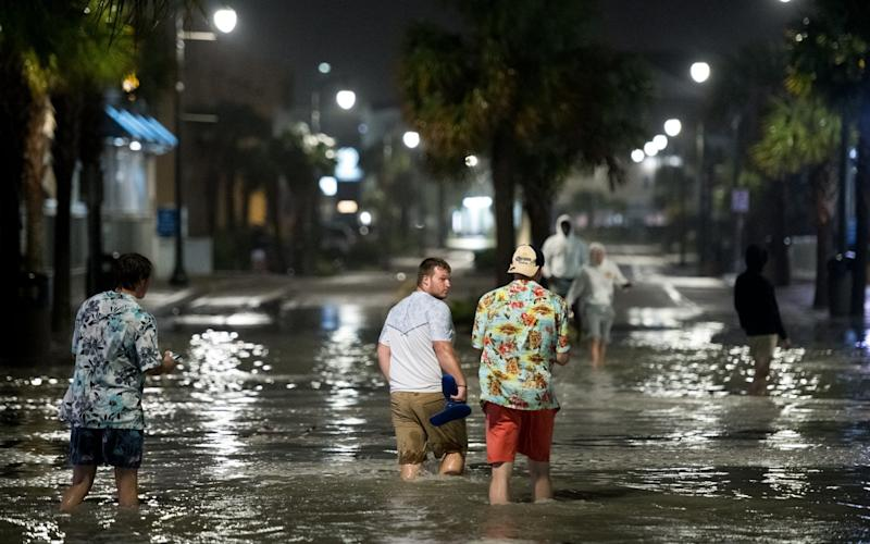 Residents of Myrtle Beach, South Carolina walk through floodwaters brought by Hurricane Isaias - Sean Rayford/Getty Images North America