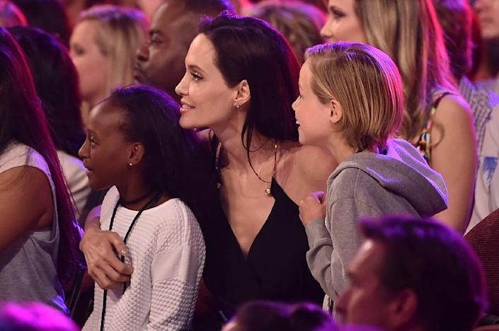 Actors Brad Pitt and Angelina Jolie sold photos of their wedding and their three newborn biological children to several publications for a fortune and then donated the money to charity (AFP Photo/Kevin Winter)