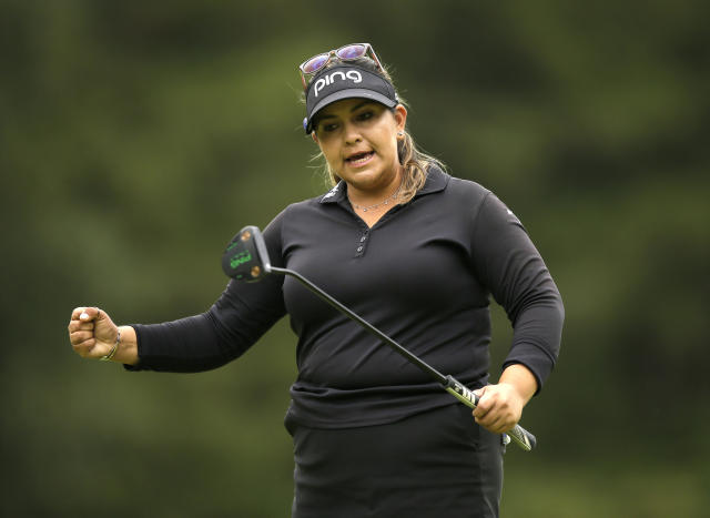 Lizette Salas of the United States celebrates getting a birdie on the 15th during the final round of the Women's British Open golf championship at Woburn Gold Club near near Milton Keynes, England, Sunday, Aug. 4, 2019. (AP Photo/Tim Ireland)