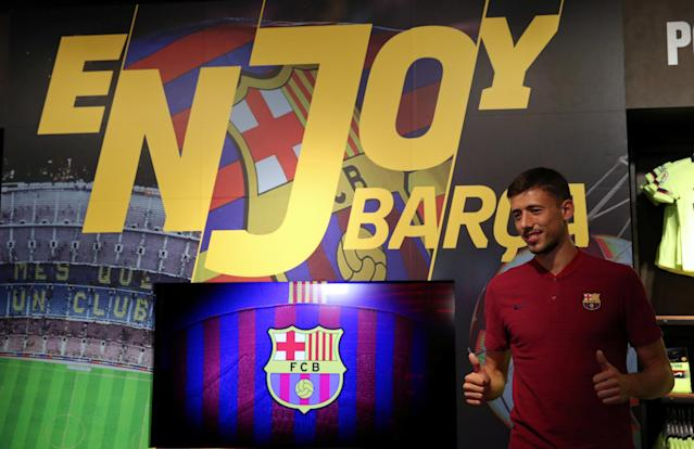 French soccer player Clement Lenglet poses in a FC Barcelona's shop next to Camp Nou stadium in Barcelona, Spain July 12, 2018. REUTERS/Albert Gea