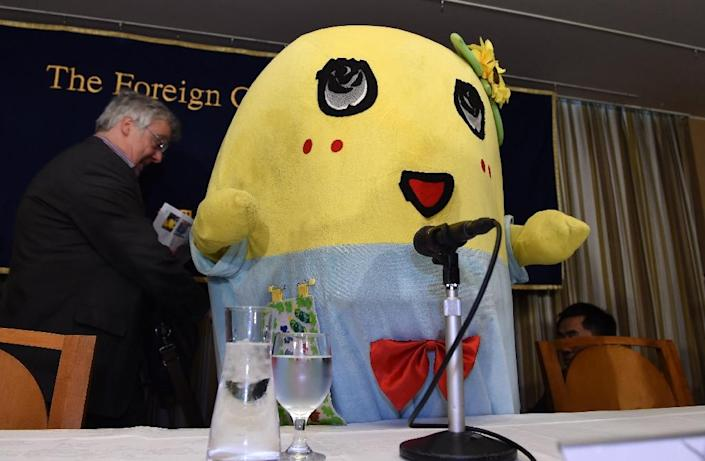 "Pear fairy ""Funassyi"", the unofficial mascot of Funabashi City in suburban Tokyo, appears at the Foreign Correspondents' Club in Tokyo on March 5, 2015 (AFP Photo/Toru Yamanaka)"