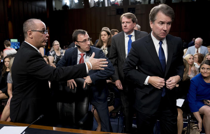 White House counsel Don McGahn, second from right, watches as Fred Guttenberg, left, father of Jamie Guttenberg, who was killed in the school shooting in Parkland, Fla., attempts to shake hands with Supreme Court nominee Brett Kavanaugh, right, as he leaves for a lunch break at a Senate Judiciary Committee hearing on Capitol Hill, Sept. 4. (Photo: Andrew Harnik/AP)