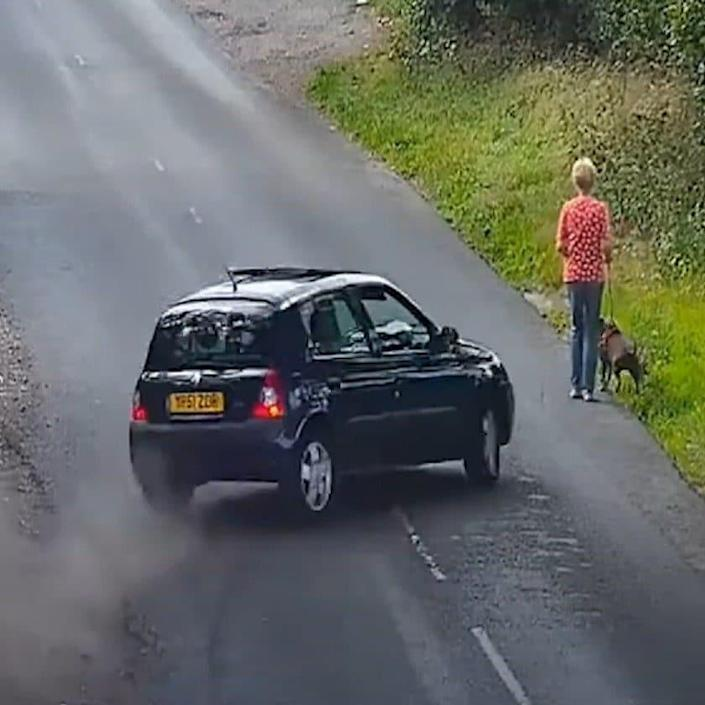 The moment before the dog-walker is mowed down by a blue Renault Clio - PA/West Midlands Police/PA/West Midlands Police