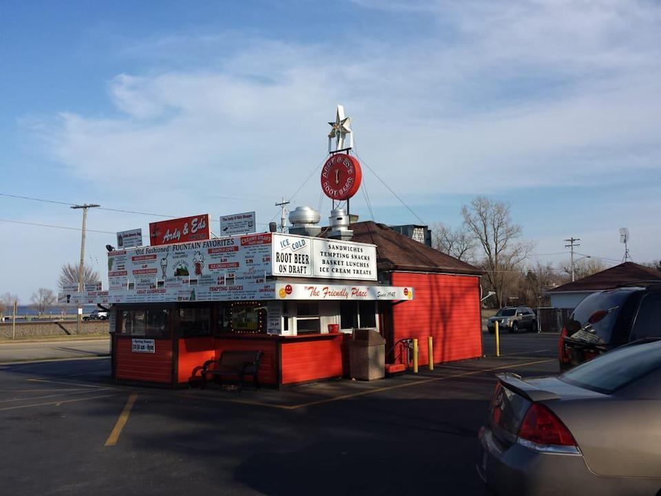 """<p>Roller skating carhops will serve you burgers and crinkle-cut fries at Ardy & Ed's Drive In. It's been around for what feels like forever, opening in 1948 as an A&W drive-in. Ardy & Ed's went independent and got its current name in the '70s, but the draft root beer is still the same and perhaps what this spot is best known for. Be sure to order some or that <a href=""""https://www.thedailymeal.com/cook/nostalgic-childhood-desserts?referrer=yahoo&category=beauty_food&include_utm=1&utm_medium=referral&utm_source=yahoo&utm_campaign=feed"""" rel=""""nofollow noopener"""" target=""""_blank"""" data-ylk=""""slk:childhood favorite dessert"""" class=""""link rapid-noclick-resp"""">childhood favorite dessert</a>, a root beer float, as you roll up and travel back in time.</p>"""