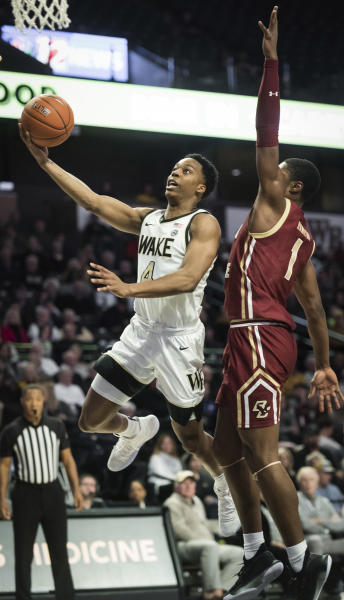 Wake Forest guard Jahcobi Neath (4) goes in for a layup with pressure from Boston College forward Jairus Hamilton (1) in the first half of a college basketball game Sunday, Jan. 19, 2020, in Winston-Salem, N.C. (Allison Lee Isley/Winston-Salem Journal via AP)