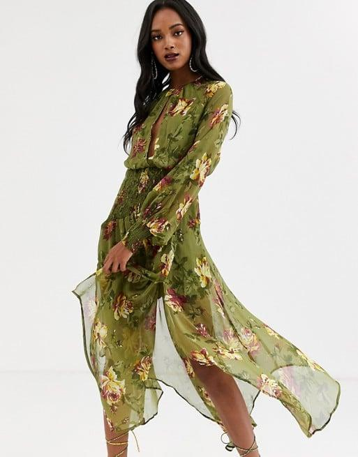 "<p>Wear this <a href=""https://www.popsugar.com/buy/ASOS-DESIGN-Drop-Waist-Shirred-Floral-Dress-484195?p_name=ASOS%20DESIGN%20Drop-Waist%20Shirred%20Floral%20Dress&retailer=us.asos.com&pid=484195&price=76&evar1=fab%3Aus&evar9=45873724&evar98=https%3A%2F%2Fwww.popsugar.com%2Ffashion%2Fphoto-gallery%2F45873724%2Fimage%2F46542390%2FASOS-DESIGN-Drop-Waist-Shirred-Floral-Dress&list1=shopping%2Cdresses%2Cspring%2Cflorals%2Cspring%20fashion&prop13=mobile&pdata=1"" rel=""nofollow"" data-shoppable-link=""1"" target=""_blank"" class=""ga-track"" data-ga-category=""Related"" data-ga-label=""https://us.asos.com/asos-design/asos-design-drop-waist-shirred-floral-midaxi-dress/prd/12978090?clr=floral-print&amp;colourWayId=16470236&amp;SearchQuery=floral%20dress"" data-ga-action=""In-Line Links"">ASOS DESIGN Drop-Waist Shirred Floral Dress</a> ($76) for a <a class=""sugar-inline-link ga-track"" title=""Latest photos and news for wedding"" href=""https://www.popsugar.com/Wedding"" target=""_blank"" data-ga-category=""Related"" data-ga-label=""https://www.popsugar.com/Wedding"" data-ga-action=""&lt;-related-&gt; Links"">wedding</a> or night out.</p>"