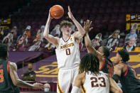 Minnesota's Liam Robbins (0) shoots as Maryland's Galin Smith (30) defends in the first half of an NCAA college basketball game, Saturday, Jan. 23, 2021, in Minneapolis. (AP Photo/Jim Mone)