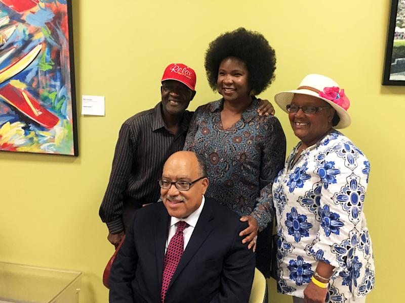 From left to right, Robert Darden, Tanya Washington and Bertha Darden pose with Fort after his first televised debate. The trio is part of a group of activists resisting a city eminent domain order in the Peoplestown neighborhood.