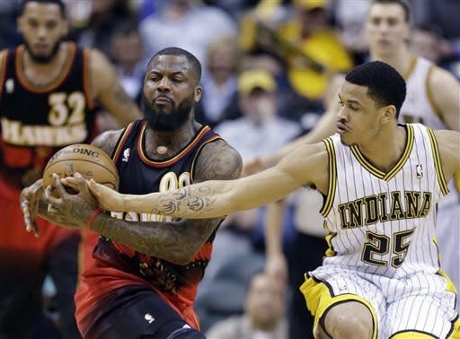 Atlanta Hawks' DeShawn Stevenson (92) is defended by Indiana Pacers' Gerald Green (25) during the second half of an NBA basketball game Monday, March 25, 2013, in Indianapolis. The Pacers defeated the Hawks 100-94. (AP Photo/Darron Cummings)