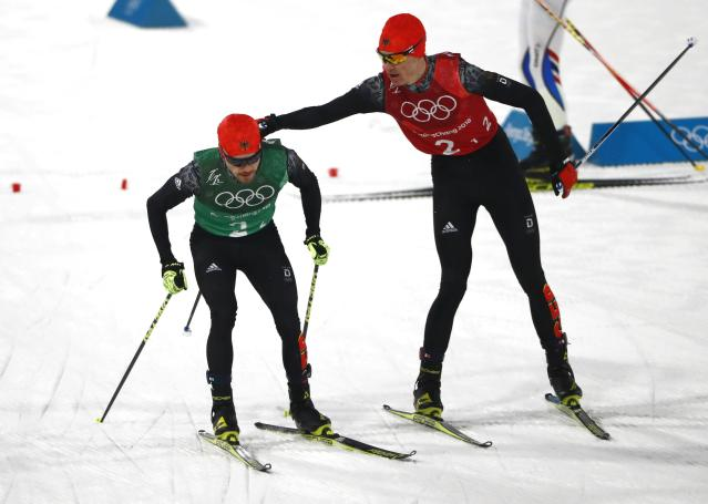 Nordic Combined Events - Pyeongchang 2018 Winter Olympics - Men's Team 4 x 5 km Final - Alpensia Cross-Country Skiing Centre - Pyeongchang, South Korea - February 22, 2018 - Vinzenz Geiger of Germany and Fabian Riessle of Germany exchange. REUTERS/Dominic Ebenbichler