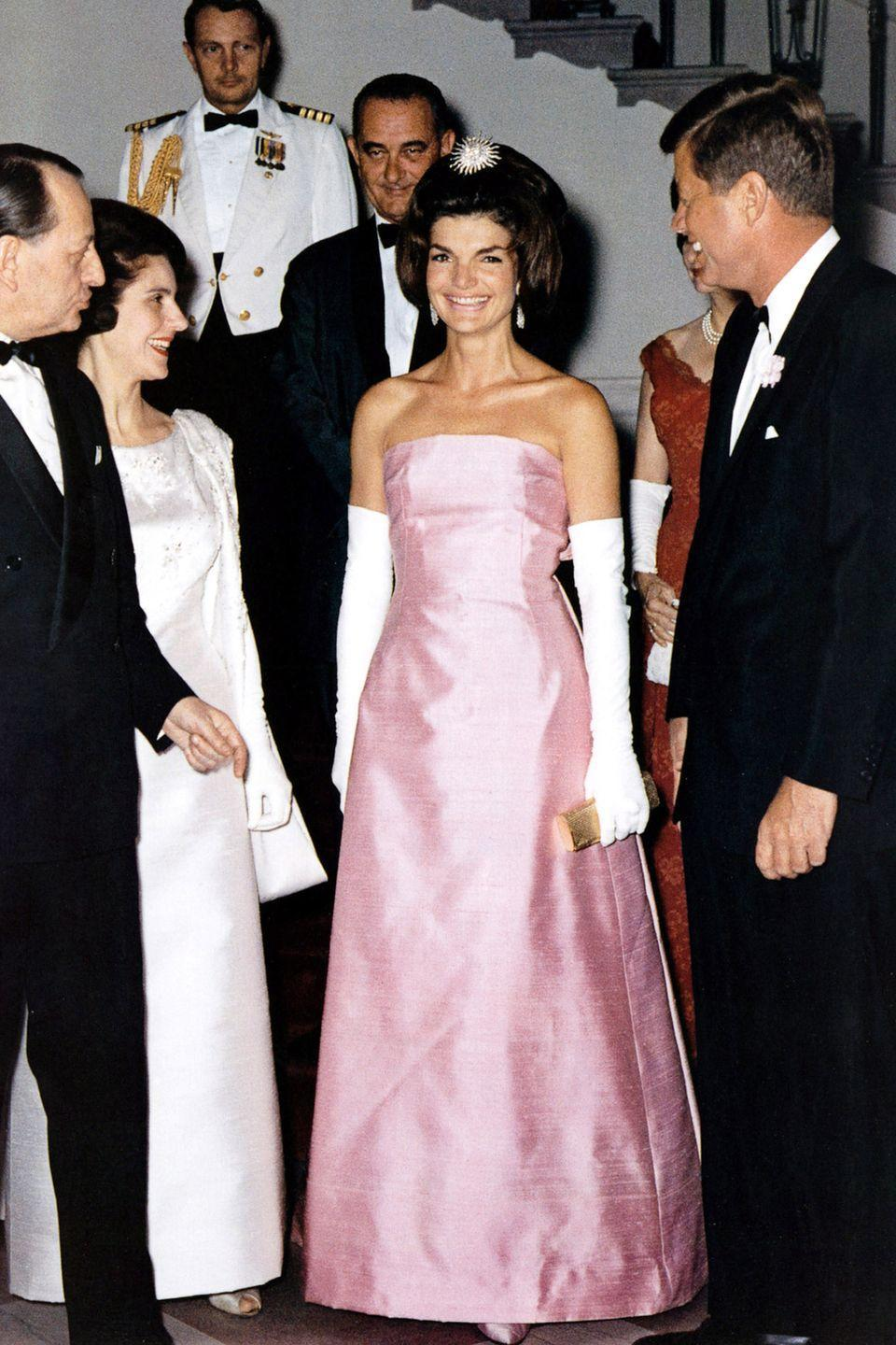 <p>Does it get any prettier than pink Christian Dior? The First Lady attended an event at the White House in this memorable strapless gown.</p>