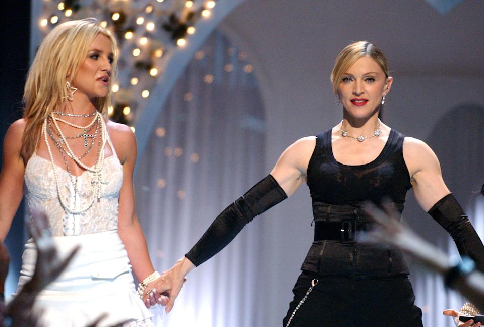 Britney Spears and Madonna during 2003 MTV Video Music Awards - Show at Radio City Music Hall in New York City, New York, United States. (Photo by Jeff Kravitz/FilmMagic)