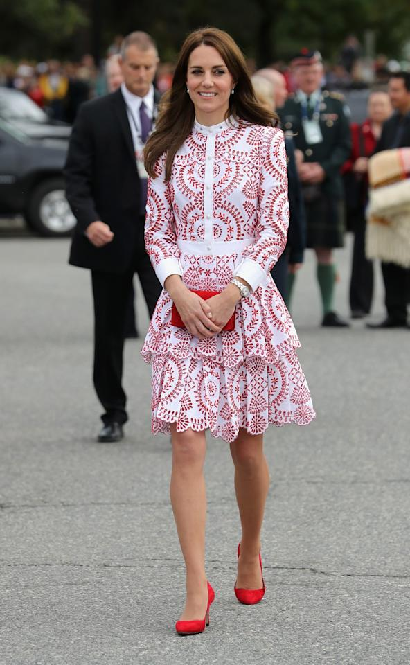 <p>The Duchess donned a bespoke red-and-white Alexander McQueen dress for a day in Vancouver. A matching Miu Miu bag and red suede heels topped off the look.<br /><i>[Photo: PA]</i> </p>