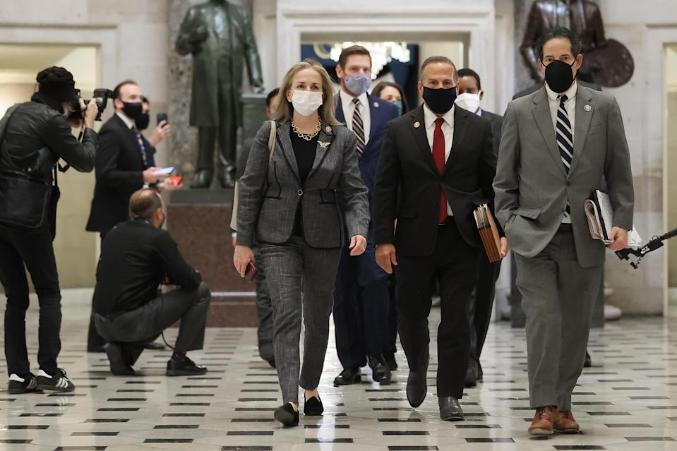 "Impeachment managers (L-R) Rep. Madeleine Dean (D-PA), Rep. Eric Swalwell (D-CA), Rep. David Cicilline (D-RI), Rep. Jamie Raskin (D-MD) and others walk through Statuary Hall while heading to vote to impeach U.S. President Donald Trump for the second time in little over a year in the House Chamber of the U.S. Capitol January 13, 2021 in Washington, DC. The House voted 232-197 to impeach Trump on the charge of ""incitement of insurrection"