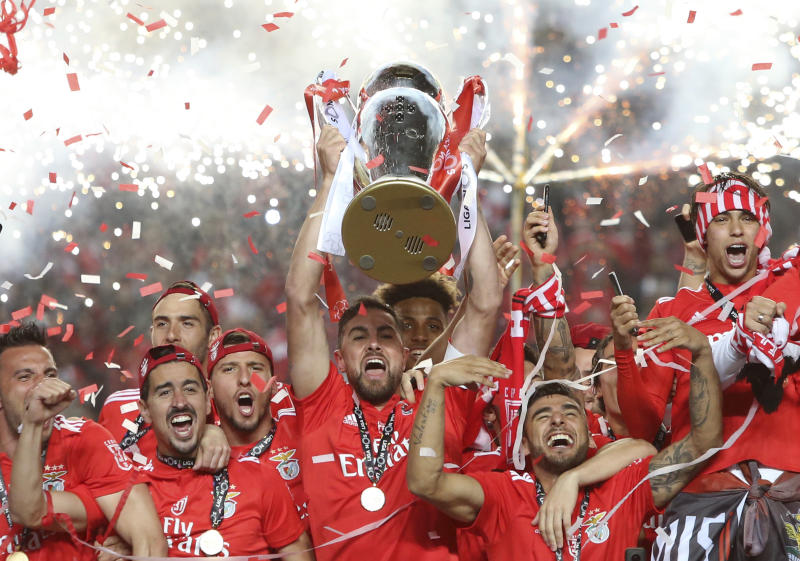 Benfica's team captain Jardel lifts the trophy after the Portuguese league last round soccer match between Benfica and Santa Clara at the Luz stadium in Lisbon, Saturday, May 18, 2019. Benfica won 4-1 to clinch the championship title. (AP Photo/Armando Franca)