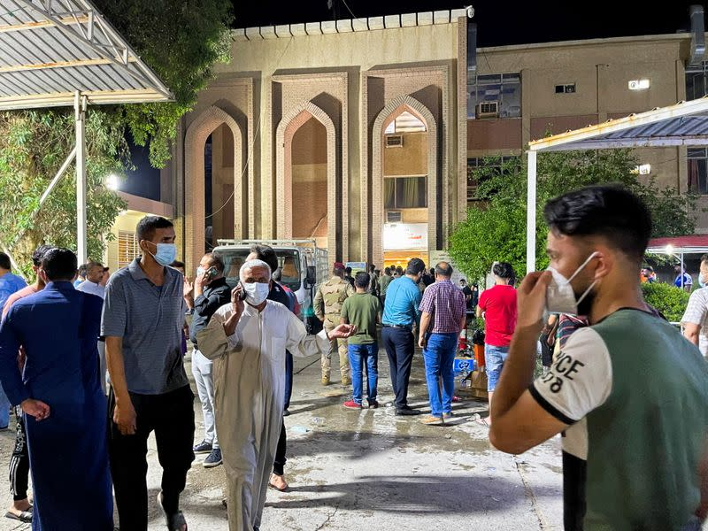 People gather inside Ibn Khatib hospital after a fire caused by an oxygen tank explosion in Baghdad
