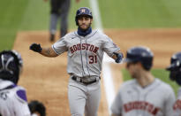 Houston Astros' Abraham Toro celebrates as he crosses home plate after hitting a three-run home run off Colorado Rockies starting pitcher German Marquez in the fifth inning of a baseball game Thursday, Aug. 20, 2020, in Denver. (AP Photo/David Zalubowski)