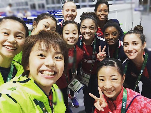 <p>Japanese gymnast Aiko Sugihara posted this snap of the Team Japan and Team USA gymnasts crossing paths in Rio. (@loveco_smile/Twitter) </p>