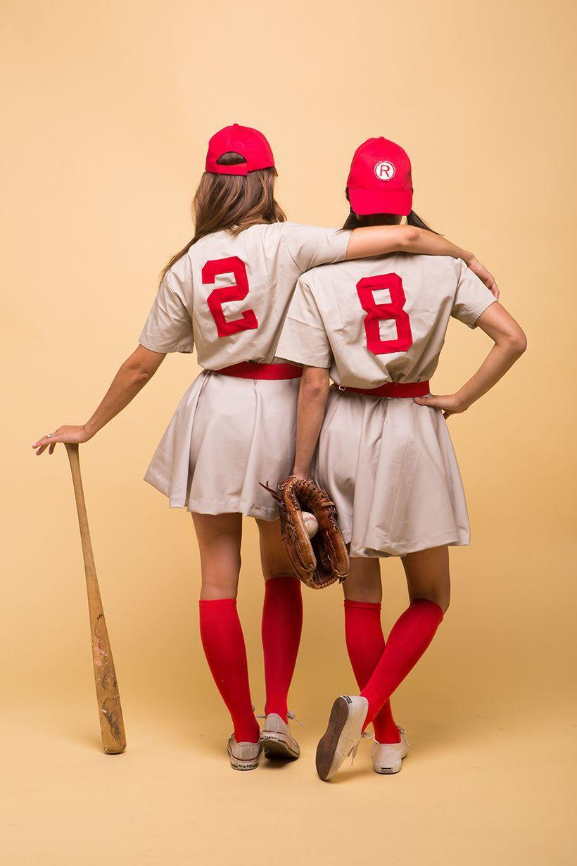 """<p>Batter up! The time has come to play ball with your best friend.</p><p><strong>Get the tutorial at <a href=""""https://camillestyles.com/halloween/a-league-of-their-own-costume/"""" rel=""""nofollow noopener"""" target=""""_blank"""" data-ylk=""""slk:Camille Styles"""" class=""""link rapid-noclick-resp"""">Camille Styles</a>.</strong></p><p><strong><a class=""""link rapid-noclick-resp"""" href=""""https://www.amazon.com/Cherokee-Womens-V-Neck-Scrub-Medium/dp/B002EAUR1Q?tag=syn-yahoo-20&ascsubtag=%5Bartid%7C10050.g.21349110%5Bsrc%7Cyahoo-us"""" rel=""""nofollow noopener"""" target=""""_blank"""" data-ylk=""""slk:SHOP KHAKI SCRUBS"""">SHOP KHAKI SCRUBS</a></strong></p>"""