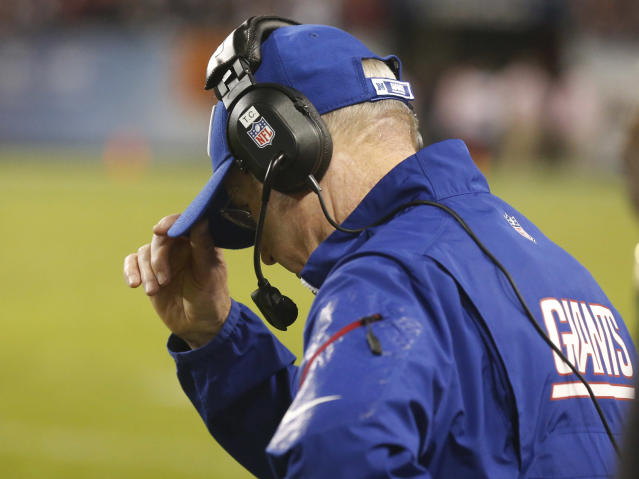 New York Giants coach Tom Coughlin walks the sidelines in the second half of an NFL football game against the Chicago Bears, Thursday, Oct. 10, 2013, in Chicago. The Bears won 27-21. (AP Photo/Charles Rex Arbogast)