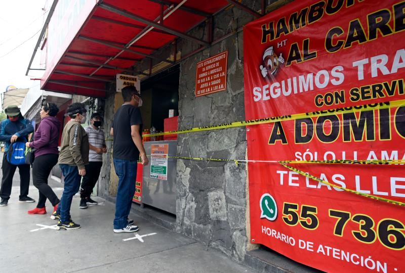 People queue waiting for their turn at a street shop in Mexico City on June 30, 2020 during the COVID-19 pandemic. - Starting this week Mexico City is allowing the reopening of shops, street markets and athletic complexes but with limited capacity and hours. Hotels and restaurants in the capital will reopen at about 30% seating capacity. (Photo by ALFREDO ESTRELLA / AFP) (Photo by ALFREDO ESTRELLA/AFP via Getty Images)