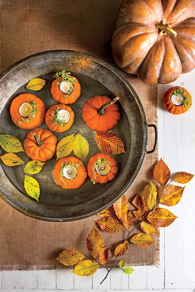 <p>This rustic look is so visually striking. Take your best apple bobbing metal tin and fill it with water, fall leaves, and pumpkin candles.</p>