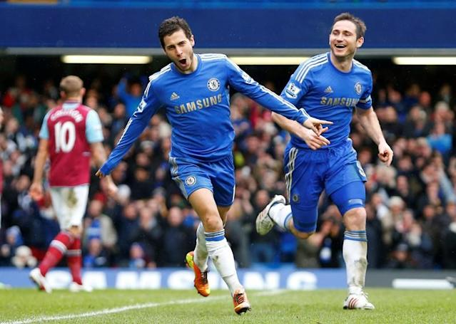 FILE PHOTO: Eden Hazard of Chelsea celebrates scoring against West Ham during their English Premier League soccer match at Stamford Bridge in London